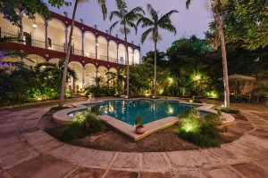 villa_merida_pool_garden_looking_to_hotel.jpg