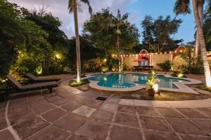 villa_merida_the_pool_garden_looking_towards_the_pool_bar.jpg